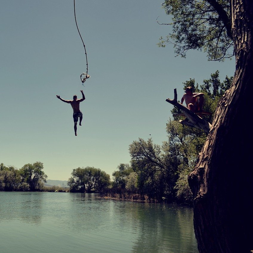 man jumping in the river